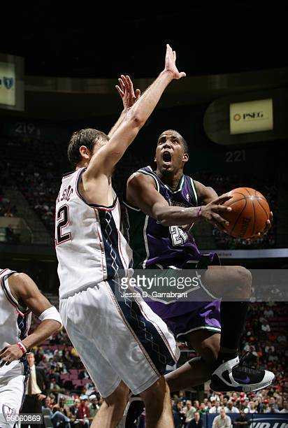 Michael Redd of the Milwaukee Bucks shoots against Nenad Krstic of the New Jersey Nets at Continental Airlines Arena November 2 2005 in East...