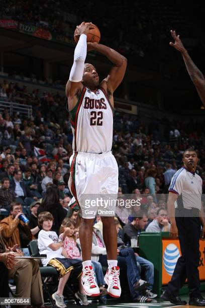 Michael Redd of the Milwaukee Bucks shoots against Tyrus Thomas of the Chicago Bulls on April 14 2008 at the Bradley Center in Milwaukee Wisconsin...