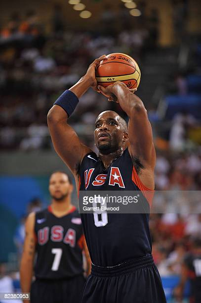 Michael Redd of the U.S. Men's Senior National Team shoots a free-throw against Spain during the group B preliminary basketball game at the Beijing...