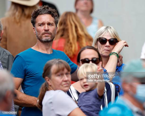 Michael Reed and Zoe Ball watch as Dame Vera Lynn's funeral cortege passes through her home village of Ditchling on route to her funeral on July 10,...
