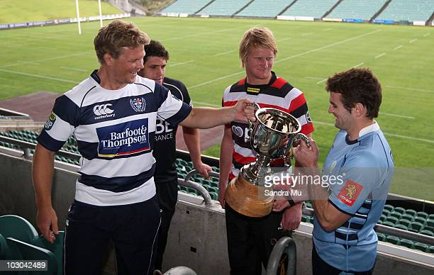 Michael Reid, captain of North Harbour and Jamie Chipman, captain of Counties Manukau look on as Daniel Braid, captain of Auckland hands the cup over...