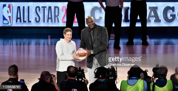 Michael Reinsdorf Jr Chicago Bulls President/COO accepts the ceremonial AllStar ball from Charlotte Hornets Chairman Michael Jordan as the Bulls will...