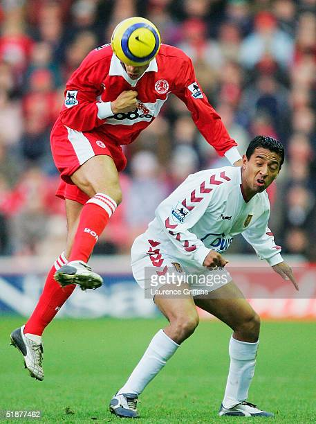 Michael Reiziger of Middlesbrough battles with Nolberto Solano of Villa during the FA Barclays Premiership match between Middlesbrough and Aston...