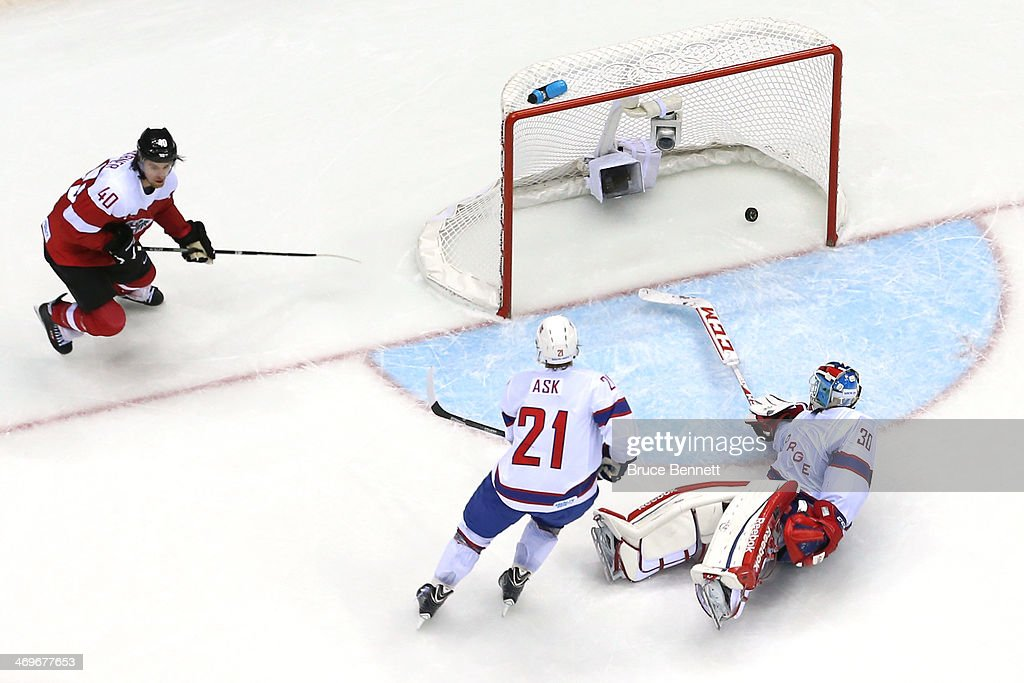 Michael Rene Grabner #40 of Austria scores a goal in the third period against Lars Haugen #30 of Norway during the Men's Ice Hockey Preliminary Round Group B game on day nine of the Sochi 2014 Winter Olympics at Bolshoy Ice Dome on February 16, 2014 in Sochi, Russia.