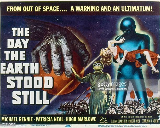 Michael Rennie as Klaatu followed by the powerful robot Gort on the poster for science fiction classic 'The Day the Earth Stood Still' 1951 American...
