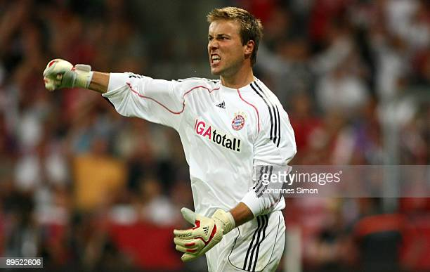 Michael Rensing, goalkeeper of Bayern celebrates after saving the ball during the penalty shootout of the Audi Cup tournament final match FC Bayern...