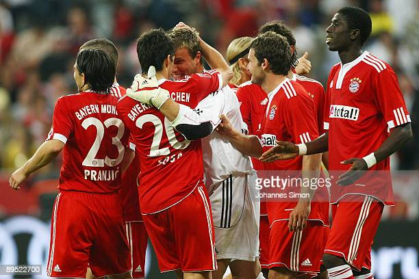 Michael Rensing goalkeeper of Bayern celebrates with his teammates after winning the penalty shootout of the Audi Cup tournament final match FC...