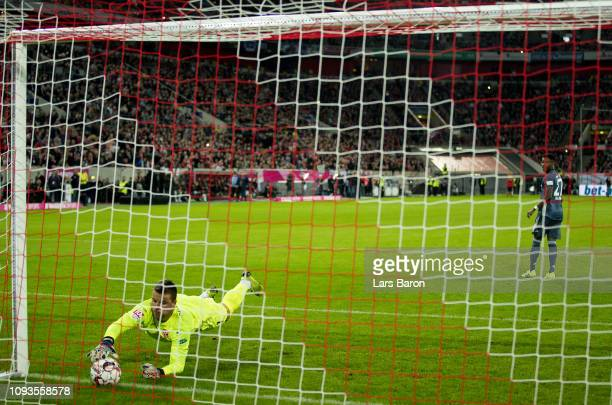 Michael Rensing of Duesseldorf stops a penalty of David Alaba of Bayern during the Telekom Cup Semifinal match between Fortuna Duesseldorf and Bayern...