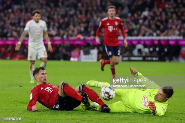 Michael Rensing of Fortuna Duesseldorf saves a shot from Leon Goretzka of Bayern Munich during the Bundesliga match between FC Bayern Muenchen and...