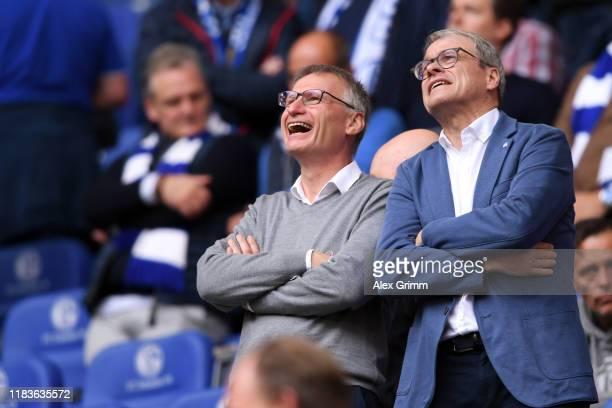 Michael Reschke and Peter Peters of Schalke look on prior to the Bundesliga match between FC Schalke 04 and Borussia Dortmund at Veltins-Arena on...