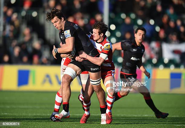 Michael Rhodes of Saracens is tackled by Billy Burns of Gloucester Rugby during the Aviva Premiership match between Saracens and Gloucester Rugby at...