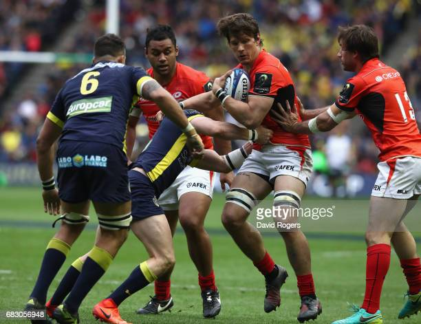 Michael Rhodes of Saracens is tackled during the European Rugby Champions Cup Final between ASM Clermont Auvergen and Saracens at Murrayfield Stadium...