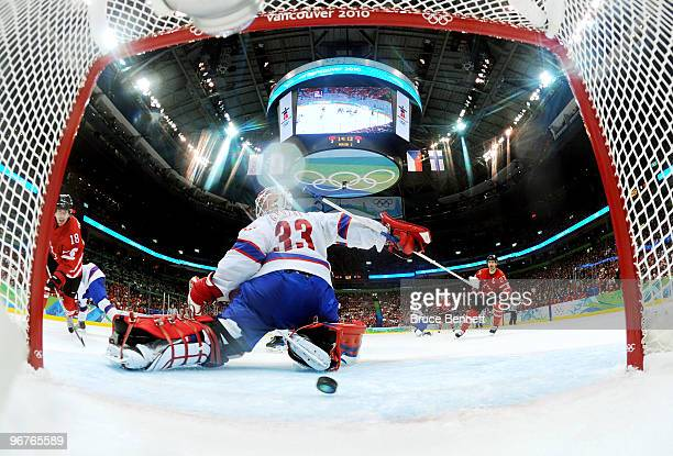 Michael Richards of Canada scores a goal past goalkeeper Pal Grotnes of Norway during the ice hockey men's preliminary game between Canada and Norway...