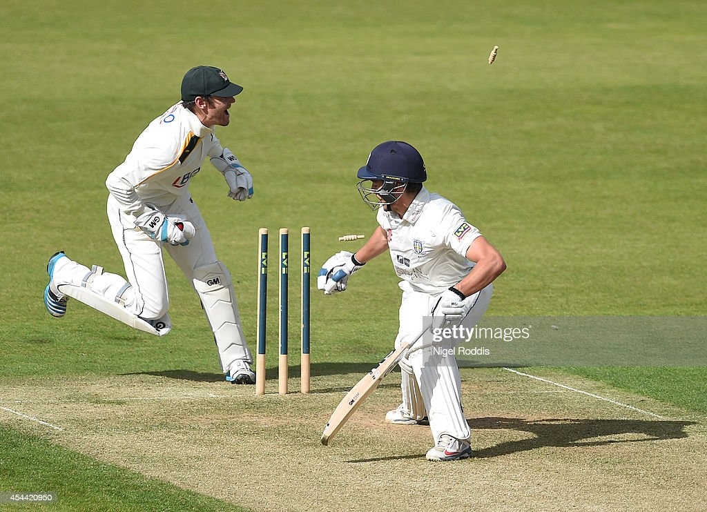 Michael Richardson of Durham is stumped by wicket keeper Chris Read (L) of Nottinghamshire during the LV County Championship match between Durham and Nottinghamshire at The Riverside on August 31, 2014 in Chester-le-Street, England.