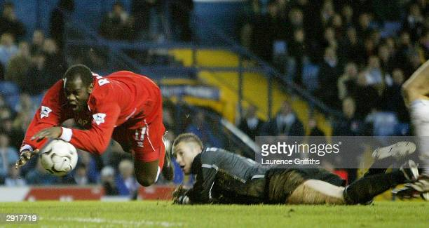 Michael Ricketts of Middlesbrough is brought down by Paul Robinson of Leeds for a penalty during the FA Barclaycard Premiership match between Leeds...