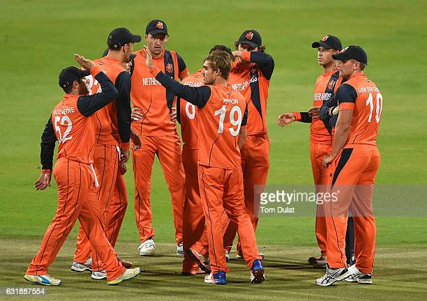 Michael Rippon of Netherlands celebrates taking the wicket of Calum MacLeod of Scotland during the Desert T20 Challenge match between Netherlands and...