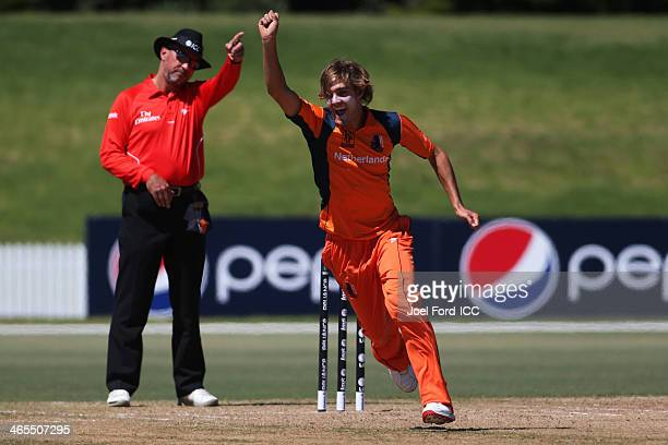 Michael Rippon of The Netherlands celebrates taking a wicket during an ICC World Cup qualifying playoff between The Netherlands and Canada on January...
