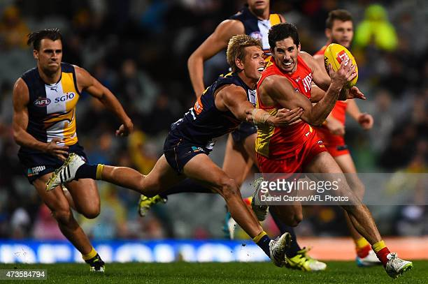Michael Rischitelli of the Gold Coast Suns is tackled by Mark LeCras of the West Coast Eagles during the round seven AFL match between the West Coast...