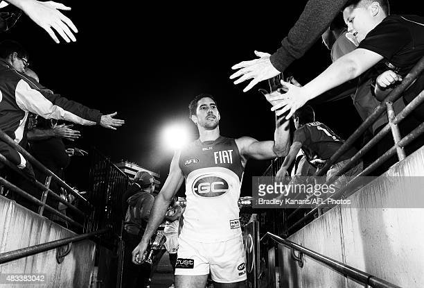 Michael Rischitelli of the Suns celebrates with fans after the 2015 AFL round 19 match between the Brisbane Lions and the Gold Coast Suns at The...