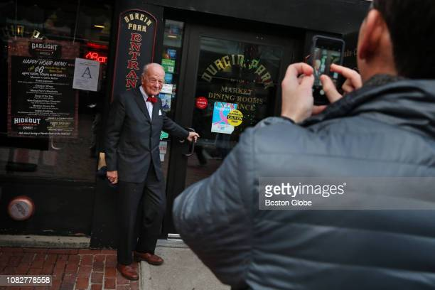 Michael Robbins has his picture taken by Vin Brod at the entrance to DurginPark in Boston on Jan 4 2019 DurginPark a centuriesold Boston landmark...