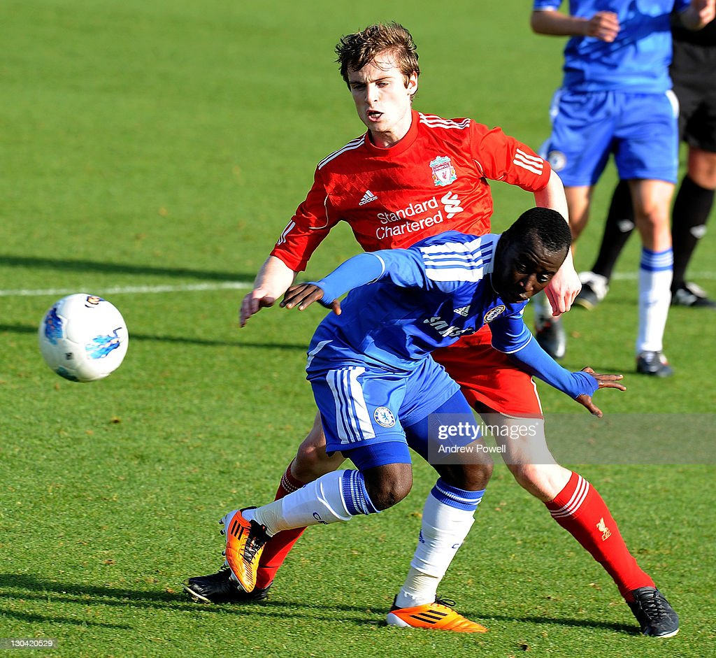 Michael Roberts of Liverpool competes with Aliu Djalo of Chelsea during the Barclays Premier Reserve League match between Liverpool Reserves and Chelsea Reserves on October 26, 2011 in Liverpool, England.