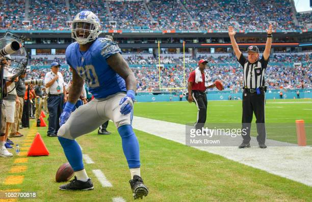Michael Roberts of the Detroit Lions celebrates after scoreing a touchdown in the third quarter against the Miami Dolphins at Hard Rock Stadium on...
