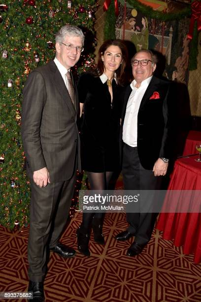 MIchael Rockefeller Allison Kanders and Warren Kanders attend A Christmas Cheer Holiday Party 2017 Hosted by George Farias Anne and Jay McInerney at...