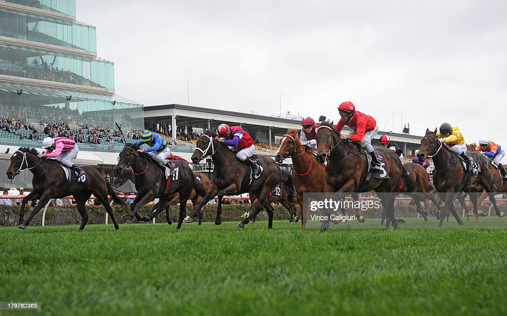 Michael Rodd riding Charlie Boy (red 5) wins the Danehill Stakes during Melbourne racing at Flemington Racecourse on September 7, 2013 in Melbourne, Australia.