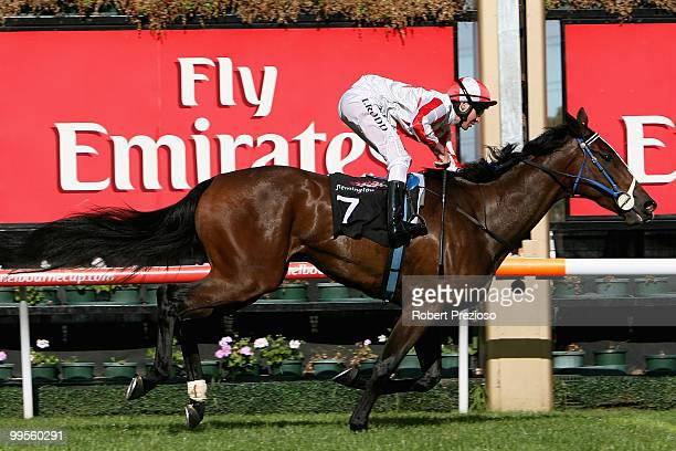 Michael Rodd riding Rain Shadow crosses the line to win race Two Trevor Clarke Handicap during the Young Members Race Day at Flemington Racecourse on...