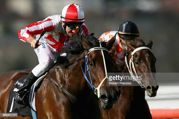 Michael Rodd riding Rain Shadow leads the field to win race Two Trevor Clarke Handicap during the Young Members Race Day at Flemington Racecourse on...