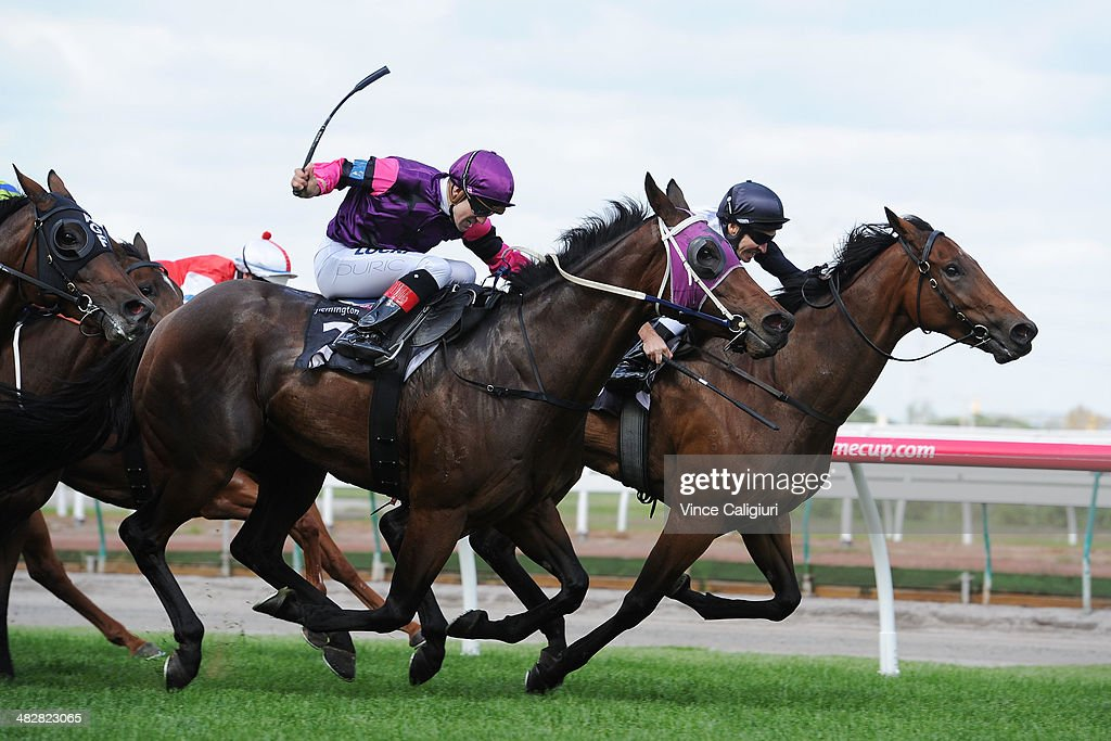 Michael Rodd riding Red Fez defeats Vlad Duric riding Gig in Race 3, the Maidstone Handicap during Melbourne Racing at Flemington Racecourse on April 5, 2014 in Melbourne, Australia.