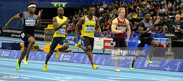 Michael Rodgers of the US wins the mens 60 metres Final Nesta Carter of Jamaica second Antoine Adams of Saint Kitts and Nevis third Kim Collins of...