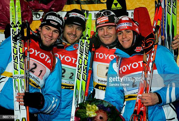Michael Roesch, Alexander Wolf, Sven Fischer and Michael Greis of Germany celebrate winning the men's 4x7.5 km relay of the Biathlon World Cup on...