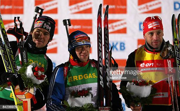 Michael Roesch of Germany, Maxim Tchoudov of Russia and Tomasz Sikora poses for a picture after the Men 10 km sprint of the E.ON Ruhrgas IBU Biathlon...