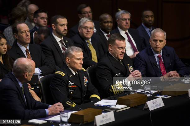Michael Rogers director of the National Security Agency second right testifies during a Senate Intelligence Committee hearing on worldwide threats in...