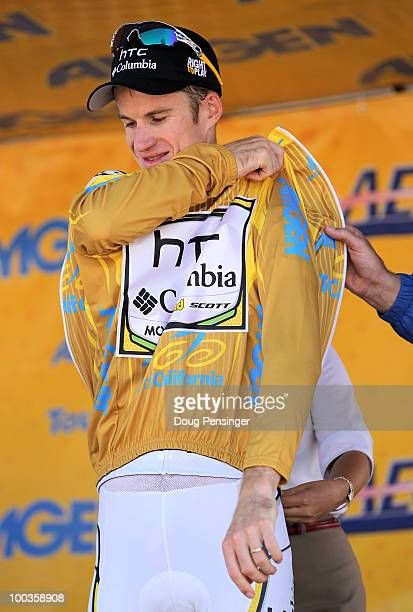 Michael Rogers of Australia and riding for HTCColumbia takes the podium after he defended the race leader's jersey to win the general classification...