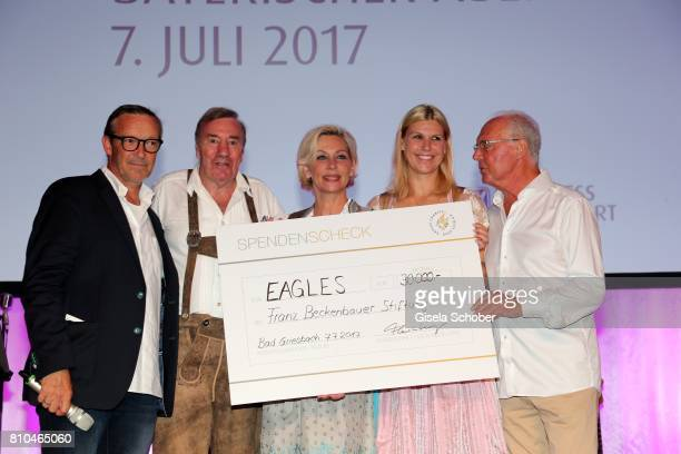 Michael Roll Frank Fleschenberg Claudia Jung Anke Huber and Franz Beckenbauer with a cheque during a bavarian evening ahead of the Kaiser Cup 2017 at...