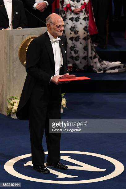 Michael Rosbash laureate of the Nobel Prize in physiology or medicine aknowledges applause after he received his Nobel Prize from King Carl XVI...