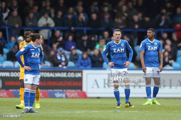 Michael Rose and Zak Jules of Macclesfield Town dejected after Paul Lewis of Cambridge United scores a goal to make it 0-1 during the Sky Bet League...