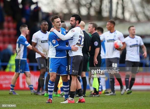 Michael Rose of Rochdale and Chris Eagles of Bury shake hands after The Emirates FA Cup Second Round match between Rochdale and Bury at Spotland on...