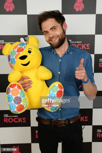 Michael Rosenberg of Passenger poses with Pudsey Bear backstage during the 'BBC Children In Need Rocks' at Hammersmith Eventim on November 13 2013 in...
