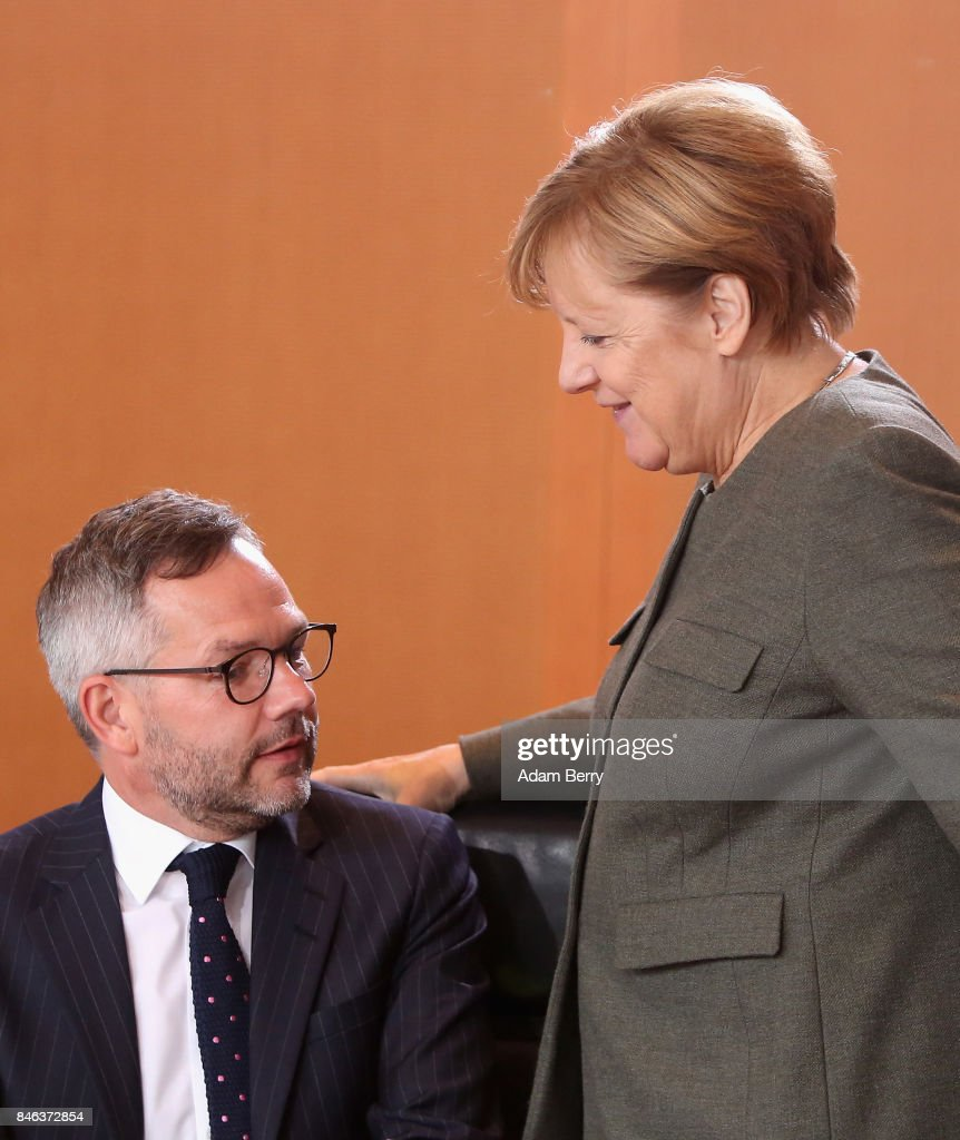 Michael Roth, state minister in the German foreign ministry (SPD, L), and German Chancellor Angela Merkel (CDU) arrive for the weekly German federal Cabinet meeting on September 13, 2017 in Berlin, Germany. High on the meeting's agenda was discussion of regional infrastructure.