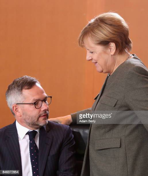 Michael Roth state minister in the German foreign ministry and German Chancellor Angela Merkel arrive for the weekly German federal Cabinet meeting...