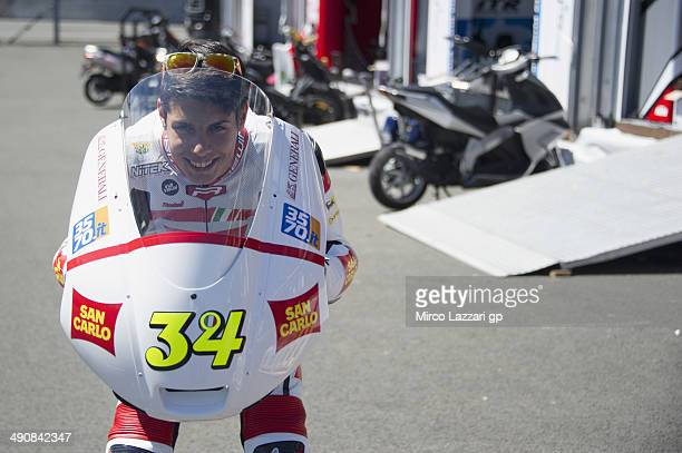 Michael Ruben Rinaldi of Italy and San Carlo Team Italya jokes in the paddock during the MotoGp of France Press Conference at on May 15 2014 in Le...
