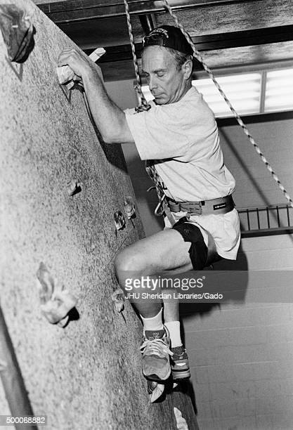 Michael Rubens Bloomberg candid shot Bloomberg has climbed to the top of a climbing wall Side view ca 47 years of age 1997