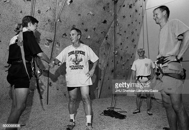 Michael Rubens Bloomberg Candid shot Bloomberg is standing in front of an indoor climbing wall with three instructors Bloomberg is shaking hands with...