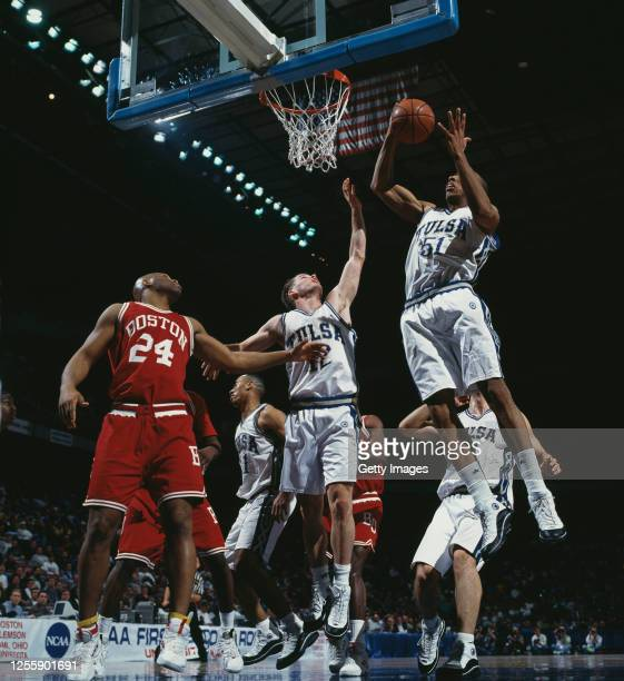 Michael Ruffin, Forward for the University of Tulsa Golden Hurricane and team mate Jonnie Gendron jump for the rebound during the NCAA Division I...