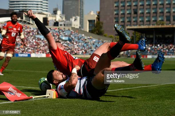 Michael Ruru of the Rebels tackles Nathan Vella of the Sunwolves during the Super Rugby match between Sunwolves and rebels at the Prince Chichibu...