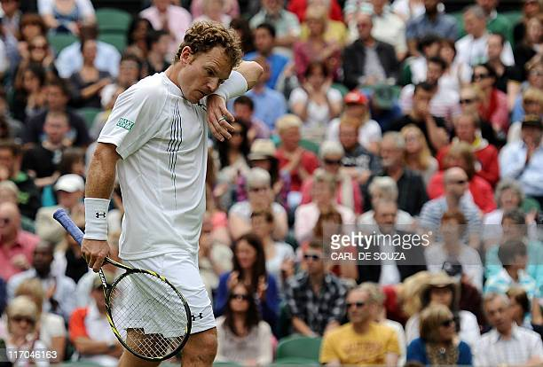 Michael Russell of US gestures as he plays against Spanish player Rafael Nadal in a Men's Singles match during the 2011 Wimbledon Tennis...