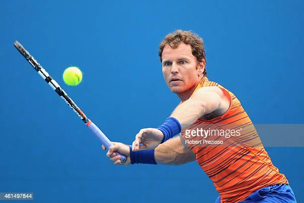 Michael Russell of USA plays a forehand in his qualifying match against Denys Molchanov of Ukraine for 2015 Australian Open at Melbourne Park on...